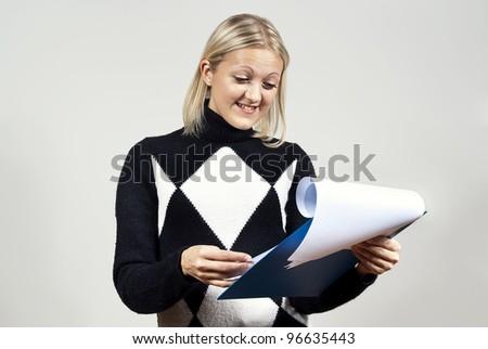 beautiful girl read contract - stock photo
