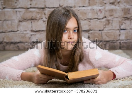 Beautiful girl reading book. Soft photo of girl with old book. education and school concept - little student girl studying and reading book at school.  - stock photo