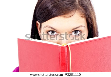 Beautiful girl reading from a big book