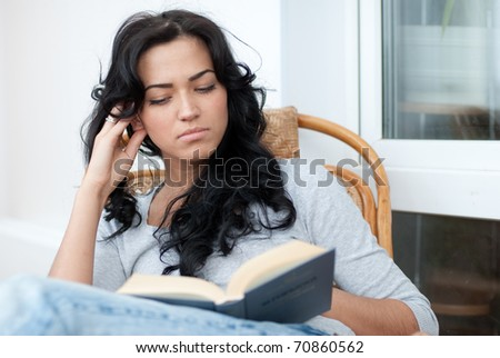Beautiful girl reading the book - stock photo