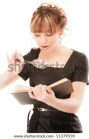 Beautiful girl reads book by means of magnifier, isolated on white background. - stock photo