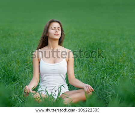 beautiful girl relaxing in a field - stock photo