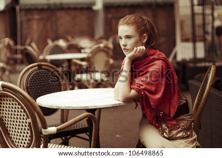 beautiful girl relaxing in the outdoor caf�© - stock photo