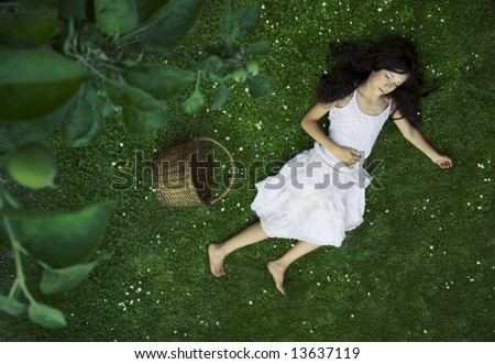 Beautiful girl relaxing on the grass