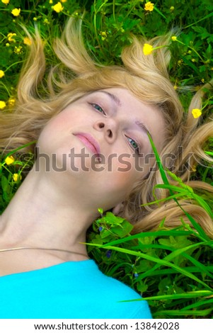 Beautiful girl relaxing on the grass - stock photo