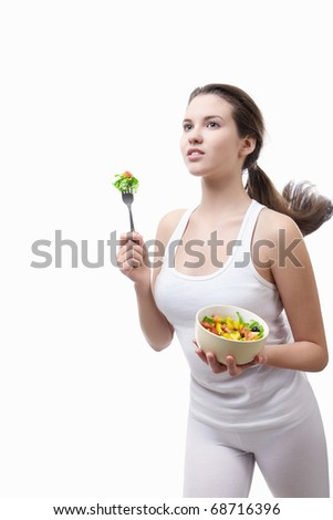 Beautiful girl running with a salad on a white background - stock photo