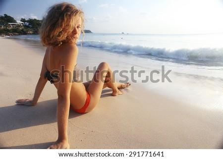beautiful girl runs along the beach in a bikini tan summer vacation - stock photo