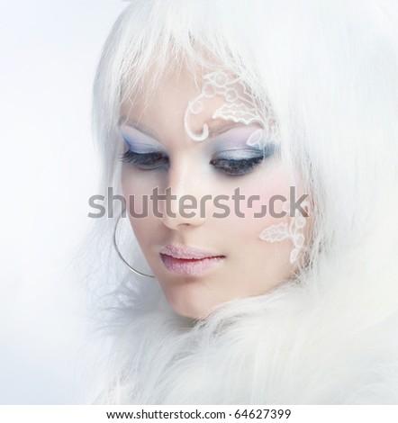 Beautiful Girl's Face.Creative Winter Makeup - stock photo