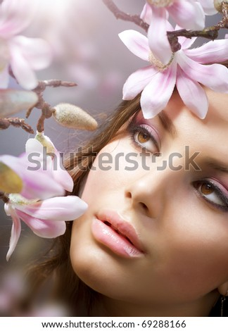 Beautiful Girl's face  with flowers - stock photo