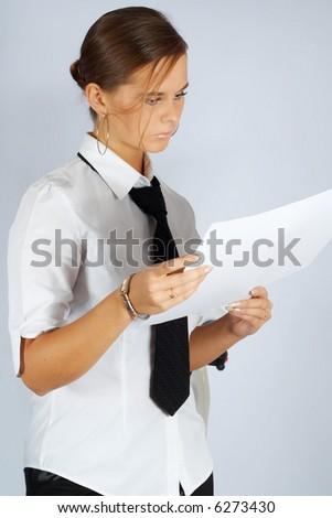 beautiful girl scrutinizing a draft - stock photo