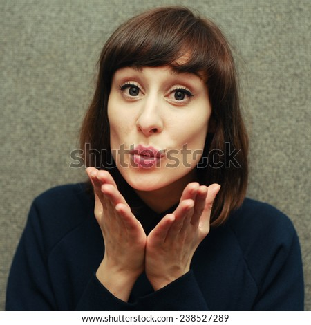 beautiful girl sending air kiss - stock photo
