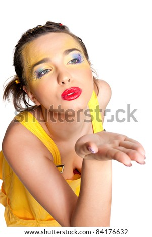 Beautiful girl sends kiss posing in studio isolated on a white background - stock photo