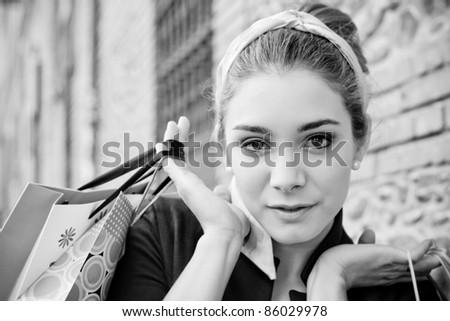 beautiful girl shopping in the city - stock photo
