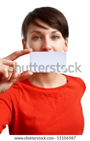 beautiful girl showing blank business card - sharpness on the card - face defocused - stock photo