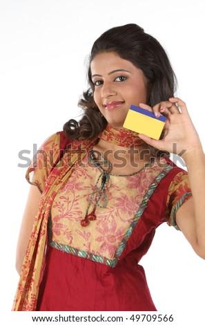Beautiful girl showing gold card - stock photo