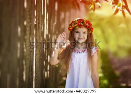 beautiful girl showing her palm. Girl with a flower wreath in her hair - stock photo