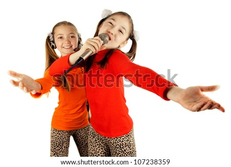 Beautiful girl singing into a microphone - stock photo