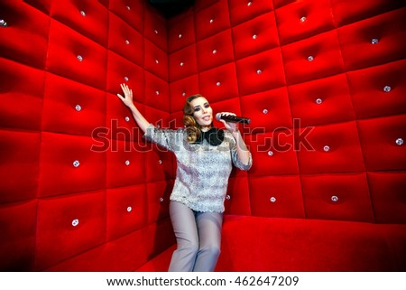 beautiful girl singing karaoke in a nightclub