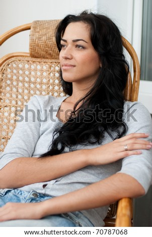 Beautiful girl sitting in the chair - stock photo