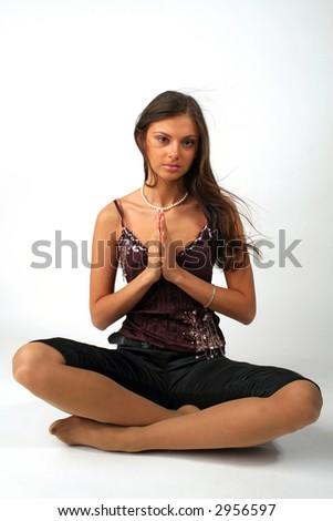 Beautiful girl sitting in yoga pose - stock photo