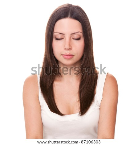 Beautiful girl sitting with eyes closed - stock photo