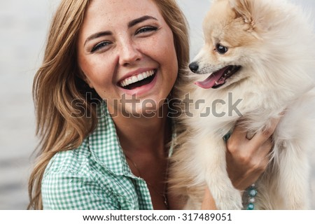 beautiful girl sitting with her little cute dog