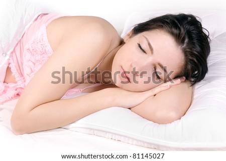 Beautiful girl sleep on bed - stock photo