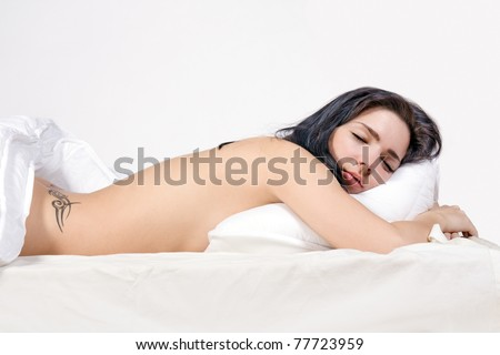 Beautiful girl sleep on bed. Nude girl lying in bed. Naked woman sleeping in bed.