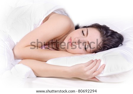 Beautiful girl sleep on bed. Teenager sleeping in white bed. Portrait of a girl dreaming on a pillow in bed. Pretty nice woman lying in bed. Cute brunette girl sleep in white bed.