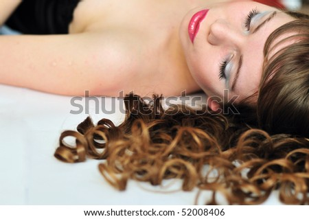 beautiful girl sleeping after party, she even has a make-up - stock photo