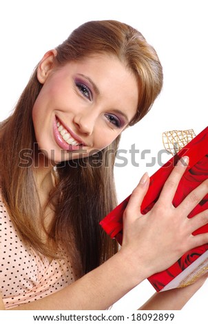 Beautiful  girl smiles and holding a gift in packing
