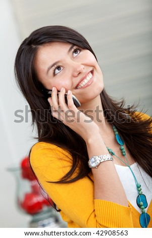 beautiful girl smiling and talking on the phone