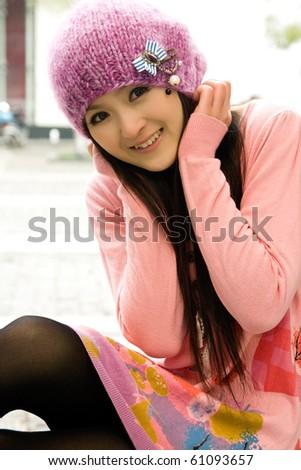 Beautiful girl smiling ,in pink coat - stock photo