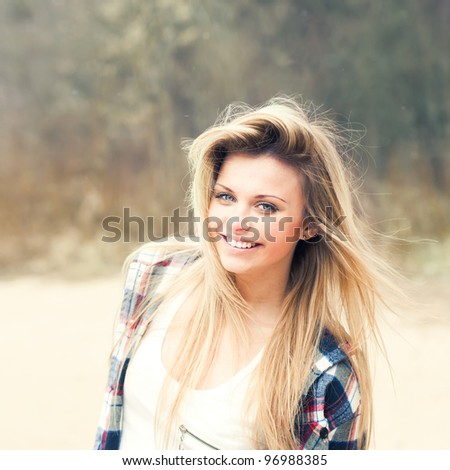 beautiful girl smiling on a sunny day - stock photo