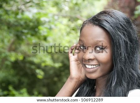 Beautiful girl smiling outdoors - stock photo