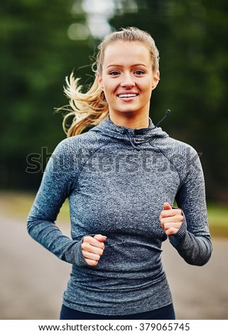 beautiful girl smiling while running - stock photo