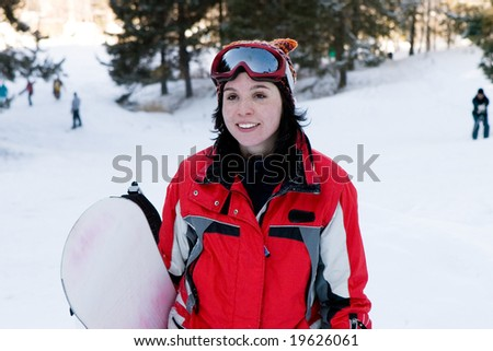 Beautiful girl snowboarder - stock photo