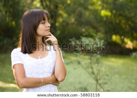 beautiful girl standing in summer park