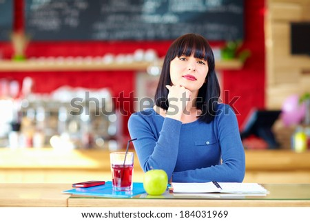 beautiful girl student in cafe