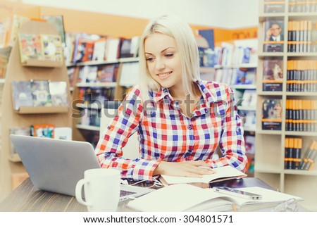 Beautiful girl studying in library  - stock photo