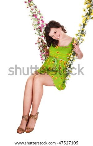 Beautiful girl swinging on flower swing. Isolated.