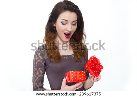 beautiful girl taken by surprise opening gift box
