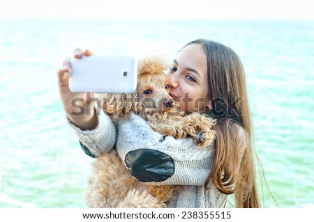 Beautiful girl taken pictures of her self, instagram - stock photo