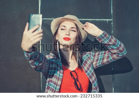 Beautiful girl taking picture of herself, selfie  - stock photo