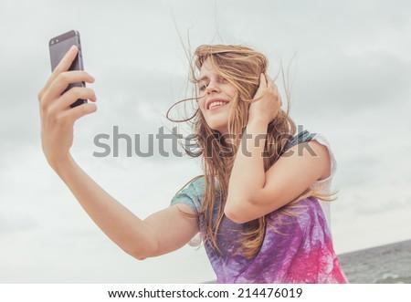 Beautiful girl taking pictures of her self, instagram, selfie - stock photo