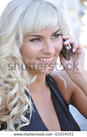 beautiful girl talking on a cell phone