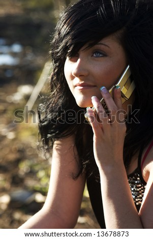 Beautiful Girl Talking on Cell Phone outside in sunshine