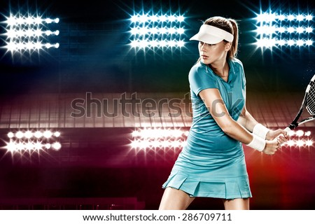 Beautiful girl tennis player with a racket on dark background wiht lights - stock photo