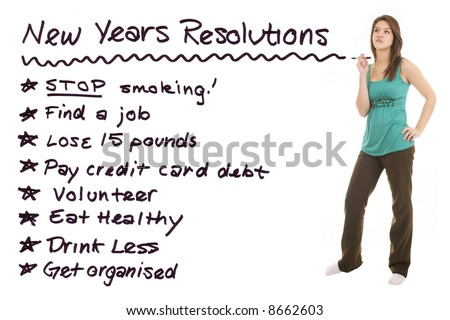 beautiful girl thinking about her New Years resolutions with a marker in her hand - stock photo