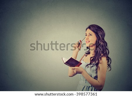 beautiful girl thinking planning - stock photo